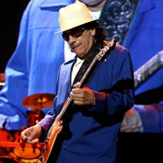 Carlos Santana has to set the groove