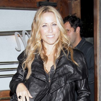 Sheryl Crow to put kids before touring