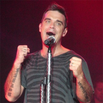 robbie-williams-planning-2012-solo-tour-2