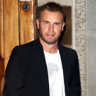 gary-barlow-auctioning-charity-seats-2