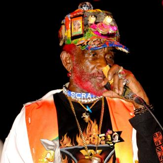 Lee 'Scratch' Perry performs to pay bills