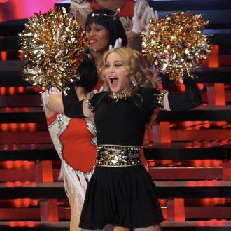 Madonna emotional over return to music