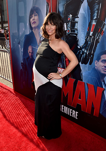 Evangeline Lilly debuts baby bump on the red carpet
