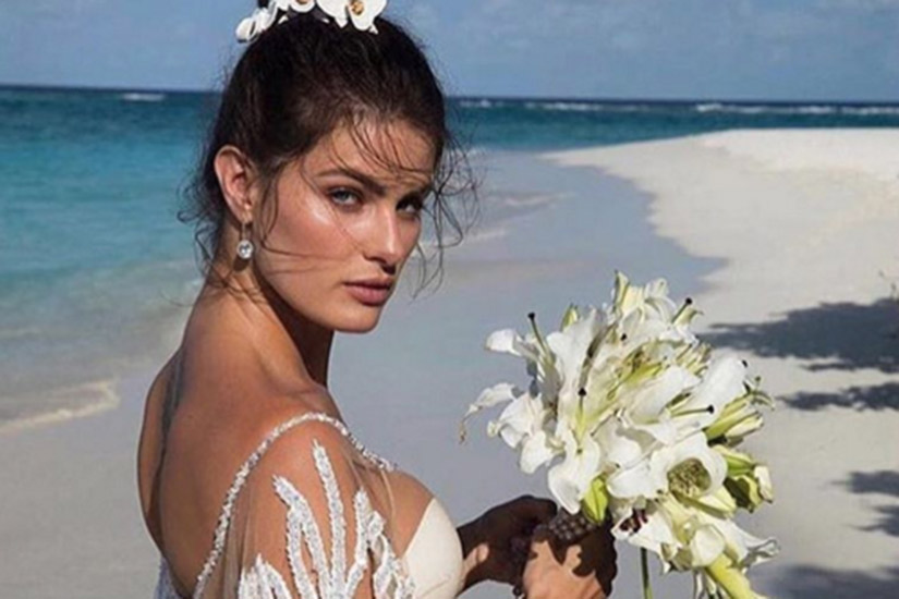 e0213155-e75e-4fba-9180-7bf0777c0434-isabeli-fontana-wedding-dress.jpg