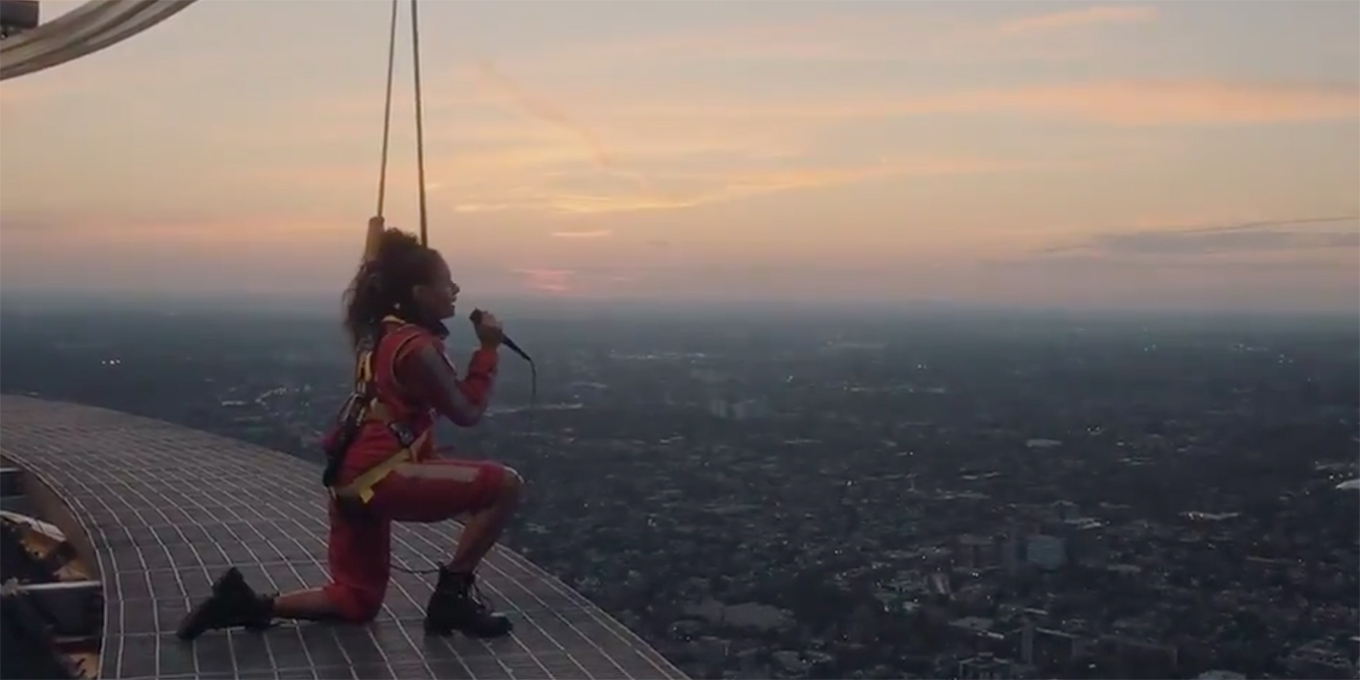 jessie-reyez-performs-oh-canada-at-the-cn-tower