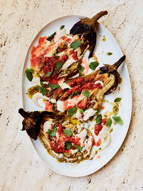 Charred whole eggplant with crushed tomato, basil and mint.