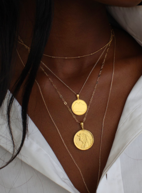 The Egyptian coin necklace stack, Omi Woods