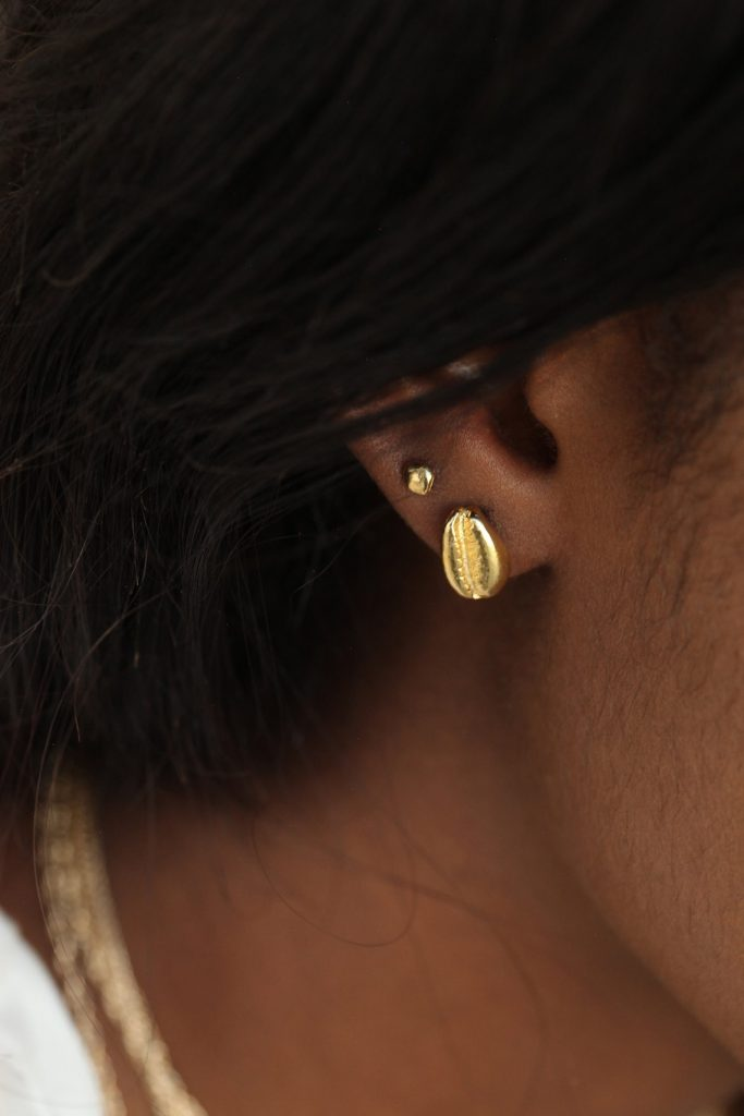 The cowrie stud earring, Omi Woods